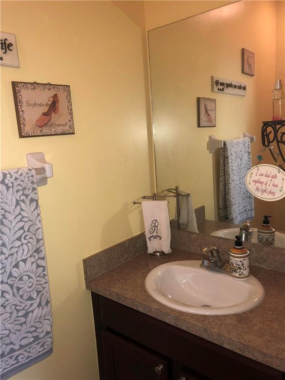 Powder room 1st floor - Single Family Home for sale at 24041 Canal St, Port Charlotte, FL 33980 - MLS Number is C7400879