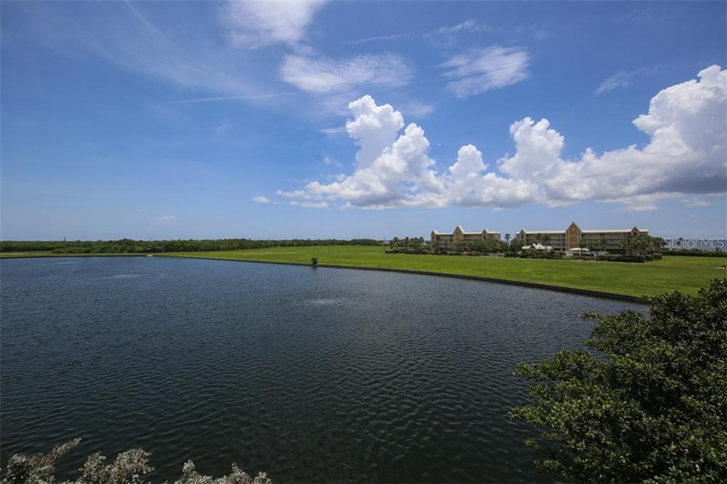 Wide lake view from lanai - Condo for sale at 95 Vivante Blvd #303, Punta Gorda, FL 33950 - MLS Number is C7402746