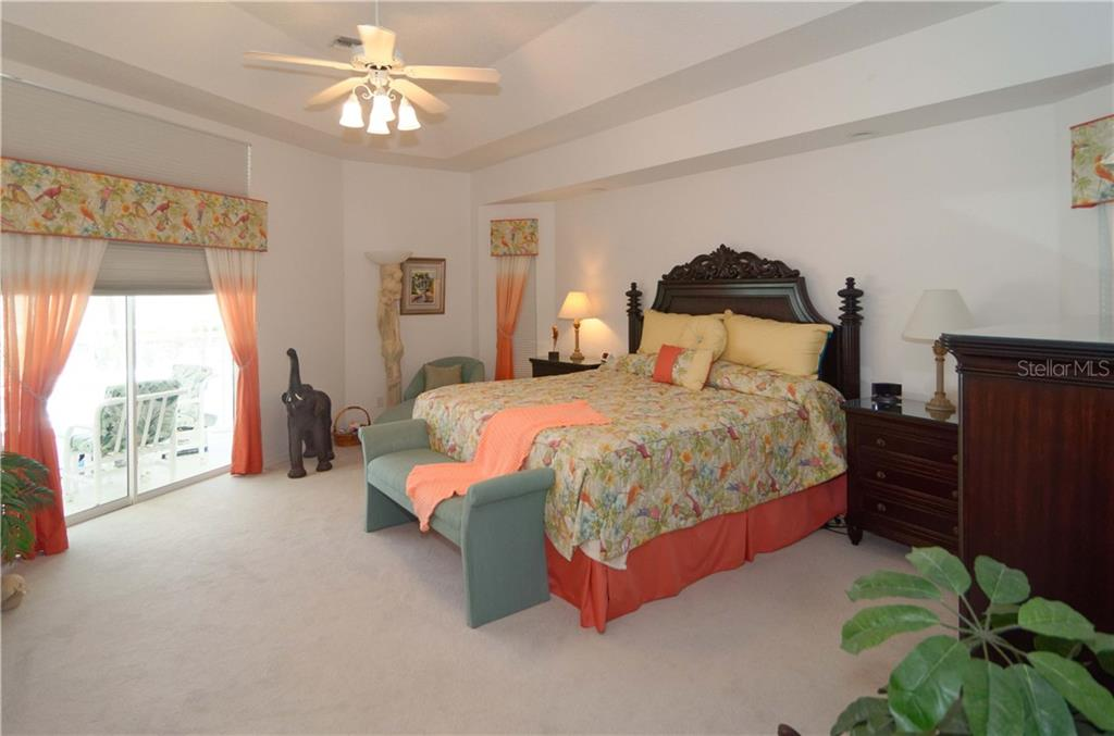 Large master bedroom with a view to the lanai.  Tray ceiling. - Single Family Home for sale at 9199 Key West St, Port Charlotte, FL 33981 - MLS Number is C7403206