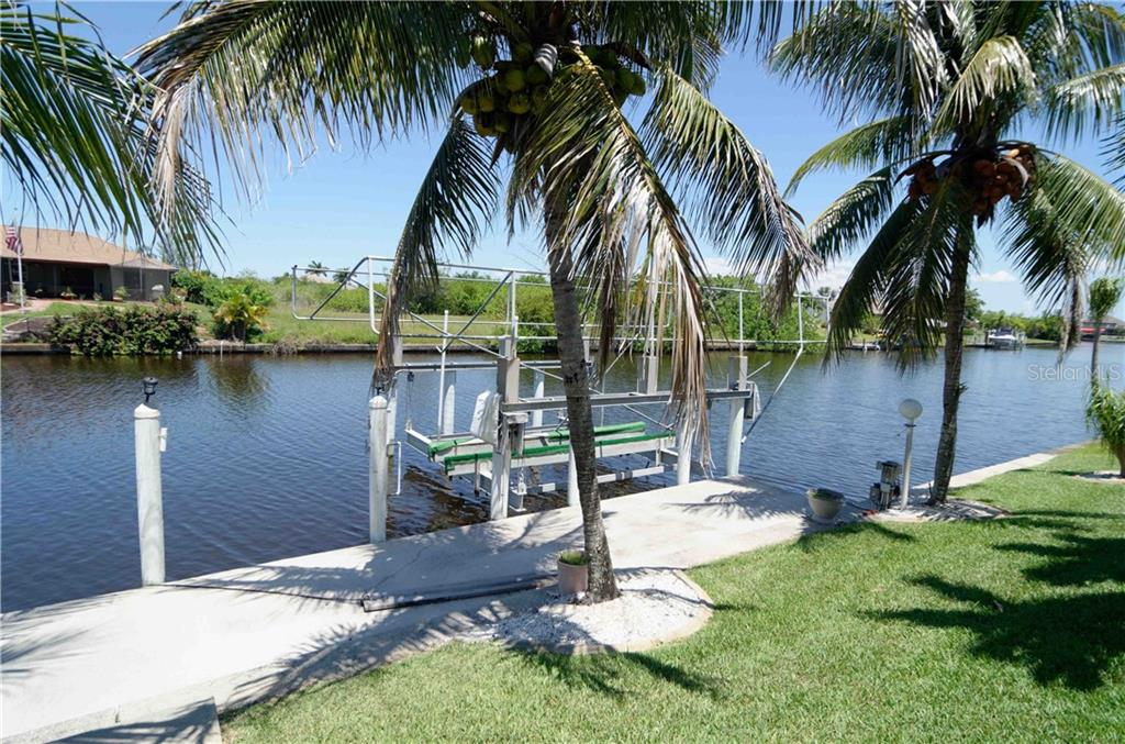 37k small yacht lift, capable of holding a 37 ft boat!  There is one bridge to the Zephyr canal, which leads directly to the Interceptor Lagoon. - Single Family Home for sale at 9199 Key West St, Port Charlotte, FL 33981 - MLS Number is C7403206