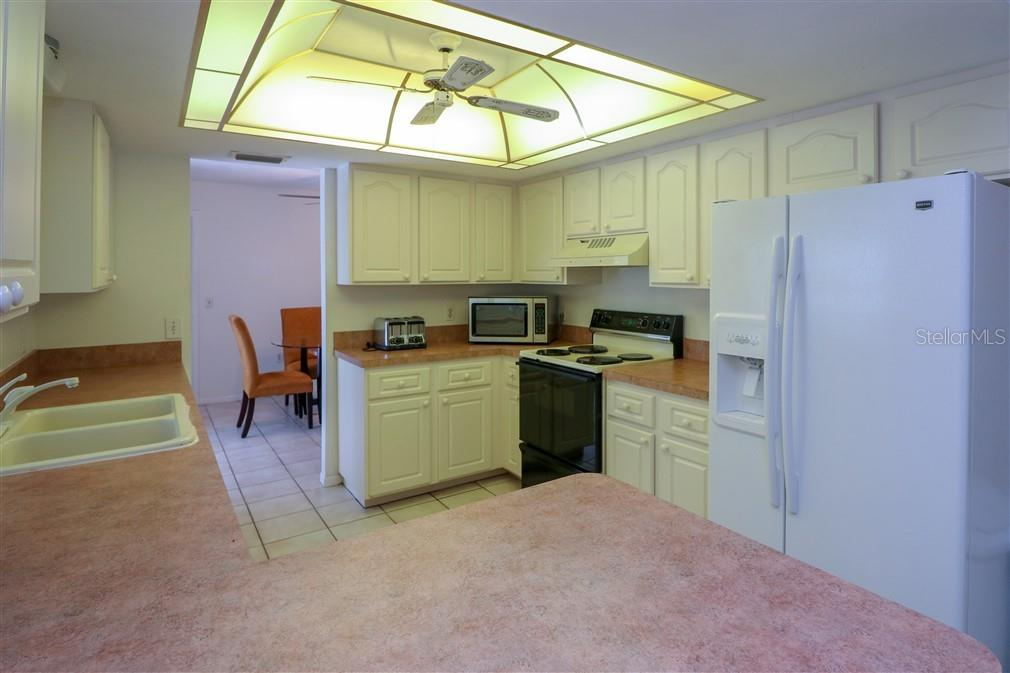 house # 1 kitchen - Single Family Home for sale at 3262 Great Neck St, Port Charlotte, FL 33952 - MLS Number is C7403390