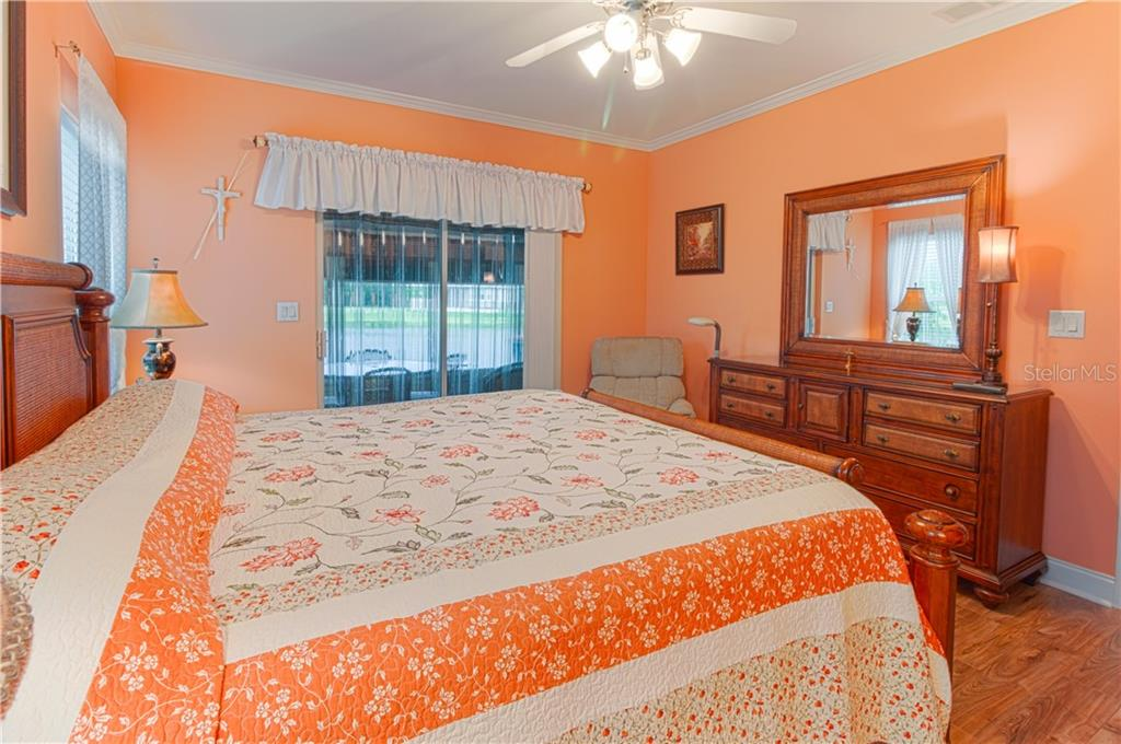 Master bedroom. View of the lake. Clear hurricane shutters installed. - Single Family Home for sale at 8663 Lake Front Ct, Punta Gorda, FL 33950 - MLS Number is C7403960
