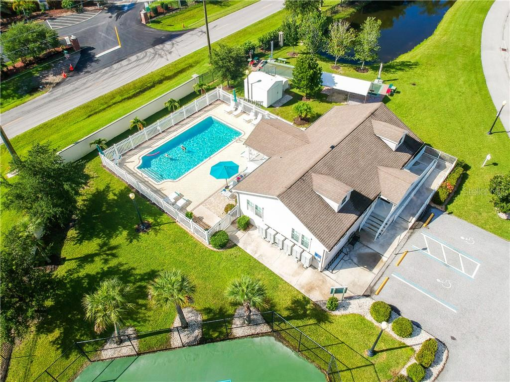 Aerial view of the club house where the fitness room is located and the heated pool - Single Family Home for sale at 8663 Lake Front Ct, Punta Gorda, FL 33950 - MLS Number is C7403960