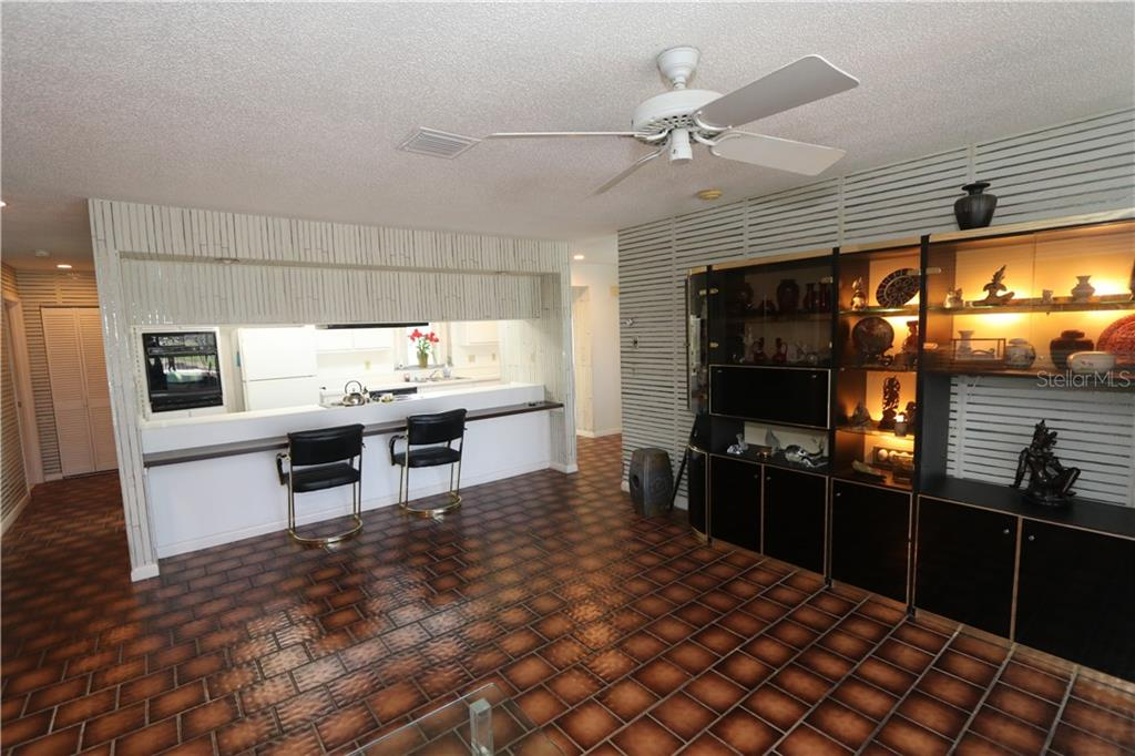 Family room with breakfast bar off the kitchen. - Single Family Home for sale at 4449 Crews Ct, Port Charlotte, FL 33952 - MLS Number is C7405049