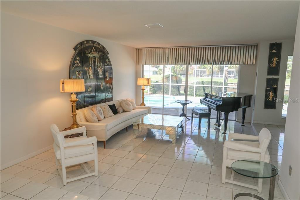 Formal living room with sliding doors out to the pool area. - Single Family Home for sale at 4449 Crews Ct, Port Charlotte, FL 33952 - MLS Number is C7405049
