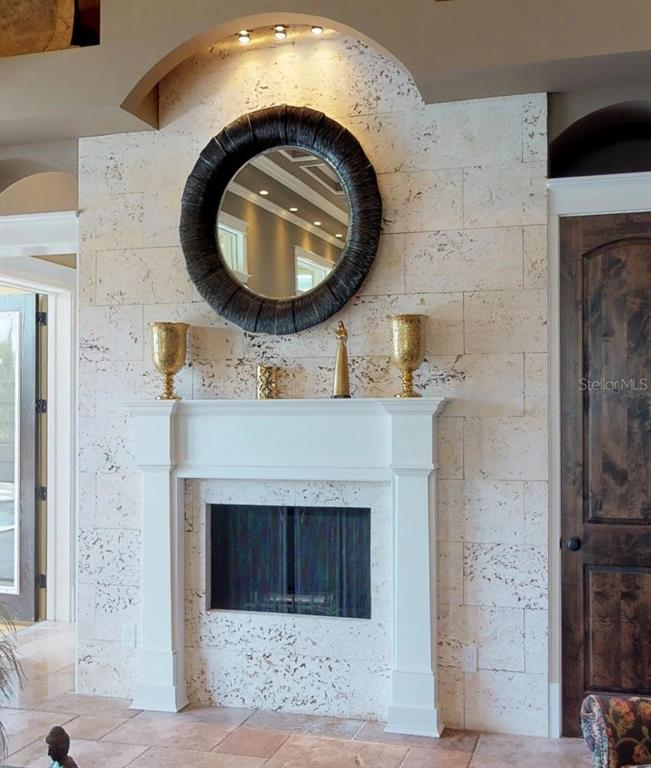 Fireplace in Living Room surrounded by Custom cut Coral Shell Stone. - Single Family Home for sale at 1289 Casper St, Port Charlotte, FL 33953 - MLS Number is C7407177