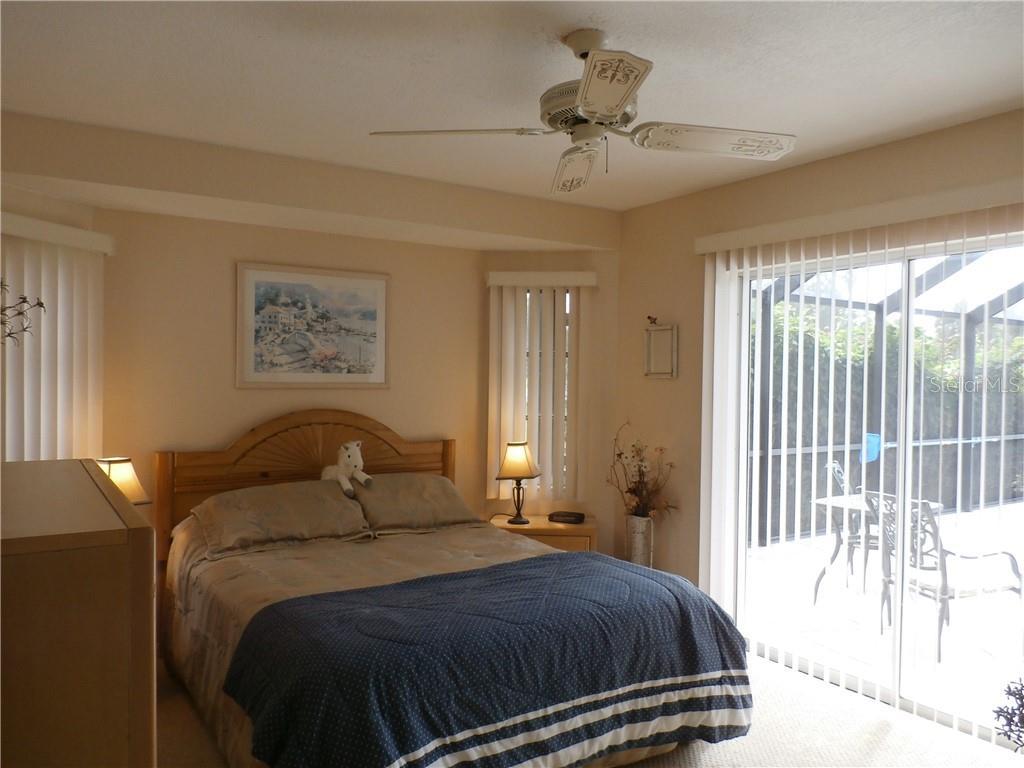 Guest bedroom with sliders to pool area - Single Family Home for sale at 416 Bahia Grande Ave, Punta Gorda, FL 33983 - MLS Number is C7408301