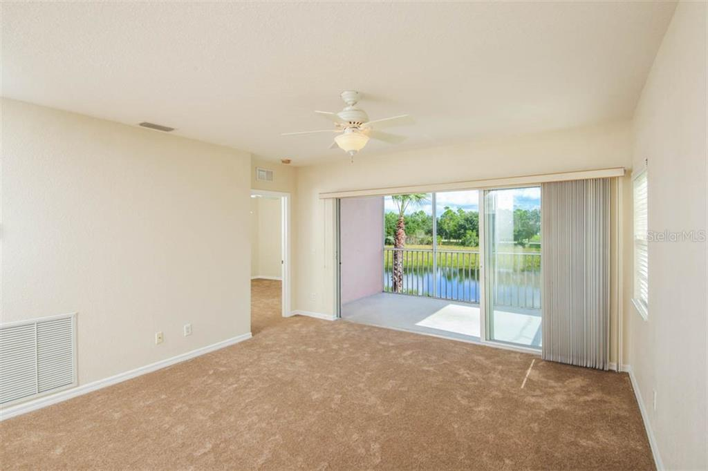 Great Room towards Lakeside Lanai & Master bedroom to the left. - Condo for sale at 2040 Willow Hammock Cir #b208, Punta Gorda, FL 33983 - MLS Number is C7408424