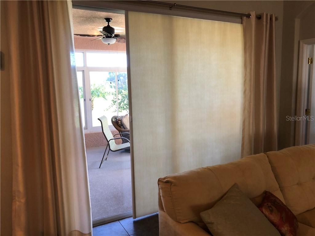 Sunscreens in both Living Room and Master Bedroom - Single Family Home for sale at 24380 Westgate Blvd, Port Charlotte, FL 33980 - MLS Number is C7408906