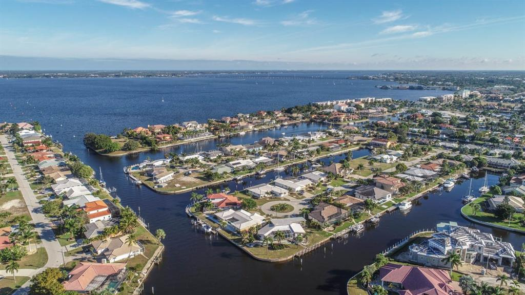 Looking north & east up the Peace River toward Port Charlotte & future Sunseeker resort. - Single Family Home for sale at 2291 Bayview Rd, Punta Gorda, FL 33950 - MLS Number is C7409445
