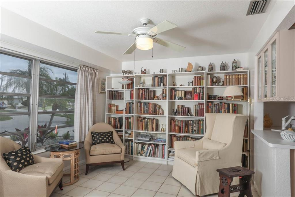 Front Library open to Kitchen is flex space-could be Dining Room or Home Office - Single Family Home for sale at 2291 Bayview Rd, Punta Gorda, FL 33950 - MLS Number is C7409445