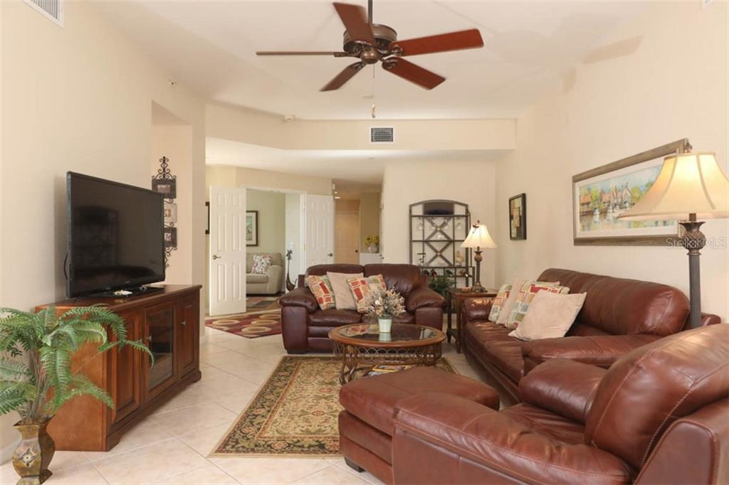 Tile on the diagonal in the great room - Condo for sale at 4643 Club Dr #102, Port Charlotte, FL 33953 - MLS Number is C7413207