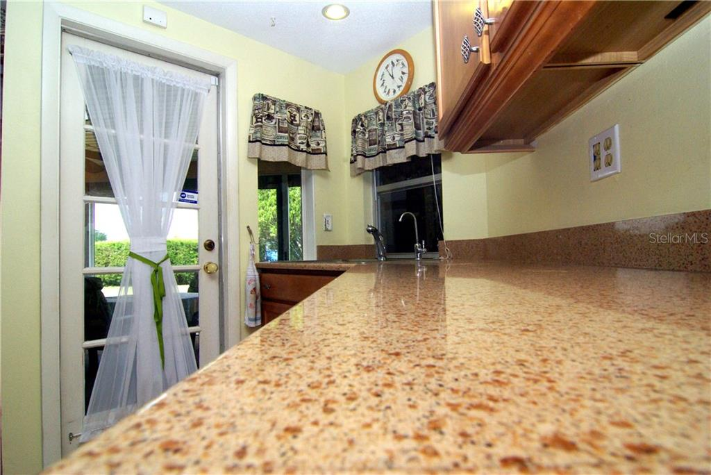 Kitchen Corian counter top - Single Family Home for sale at 2195 Abscott St, Port Charlotte, FL 33952 - MLS Number is C7414291