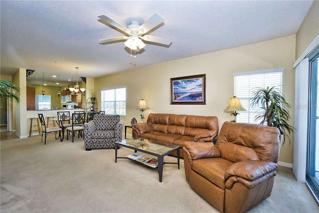 Looking from great room to dining room and onto kitchen - Condo for sale at 8405 Placida Rd #401, Placida, FL 33946 - MLS Number is C7414726