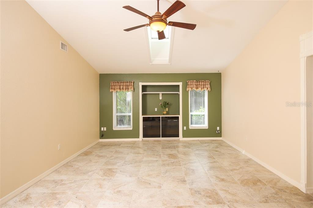 Virtually staged: Family Room with hall to BR 2 & 3 - Single Family Home for sale at 2713 Saint Thomas Dr, Punta Gorda, FL 33950 - MLS Number is C7417491