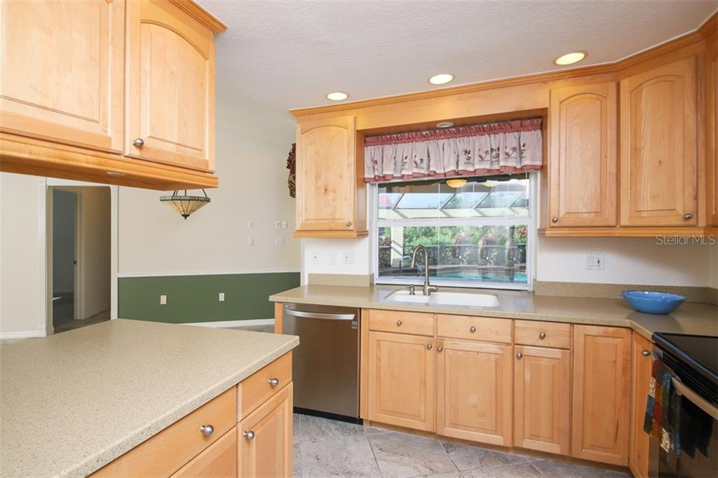 virtually staged Living & Dining looking to entry - Single Family Home for sale at 2713 Saint Thomas Dr, Punta Gorda, FL 33950 - MLS Number is C7417491