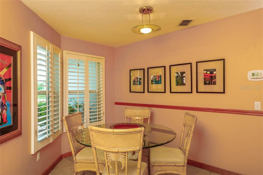 At the opposite end of the galley kitchen is this dining nook that looks out to the manicured front lawn. - Single Family Home for sale at 1633 Islamorada Blvd, Punta Gorda, FL 33955 - MLS Number is C7418555