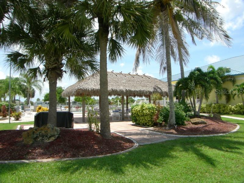 Enjoy luaus at the Tiki Hut - Manufactured Home for sale at 31 Freeman Ave, Punta Gorda, FL 33950 - MLS Number is C7420702