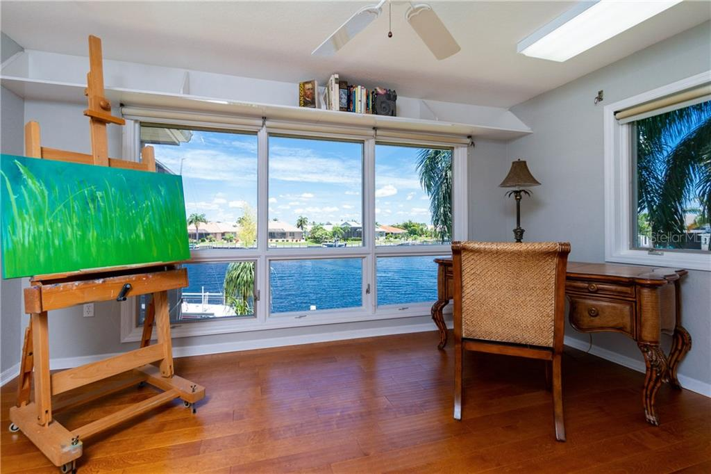 SECOND FLOOR OFFICE/STUDY/ART STUDIO WITH LOTS OF NATURAL LIGHT AND BIG WATER VIEWS - Single Family Home for sale at 3537 Caya Largo Ct, Punta Gorda, FL 33950 - MLS Number is C7431664
