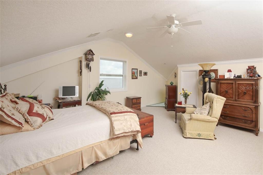 This is the previous photo depicting the large area used as a bedroom and sitting area. - Condo for sale at 4410 Warren Ave #511, Port Charlotte, FL 33953 - MLS Number is C7432222