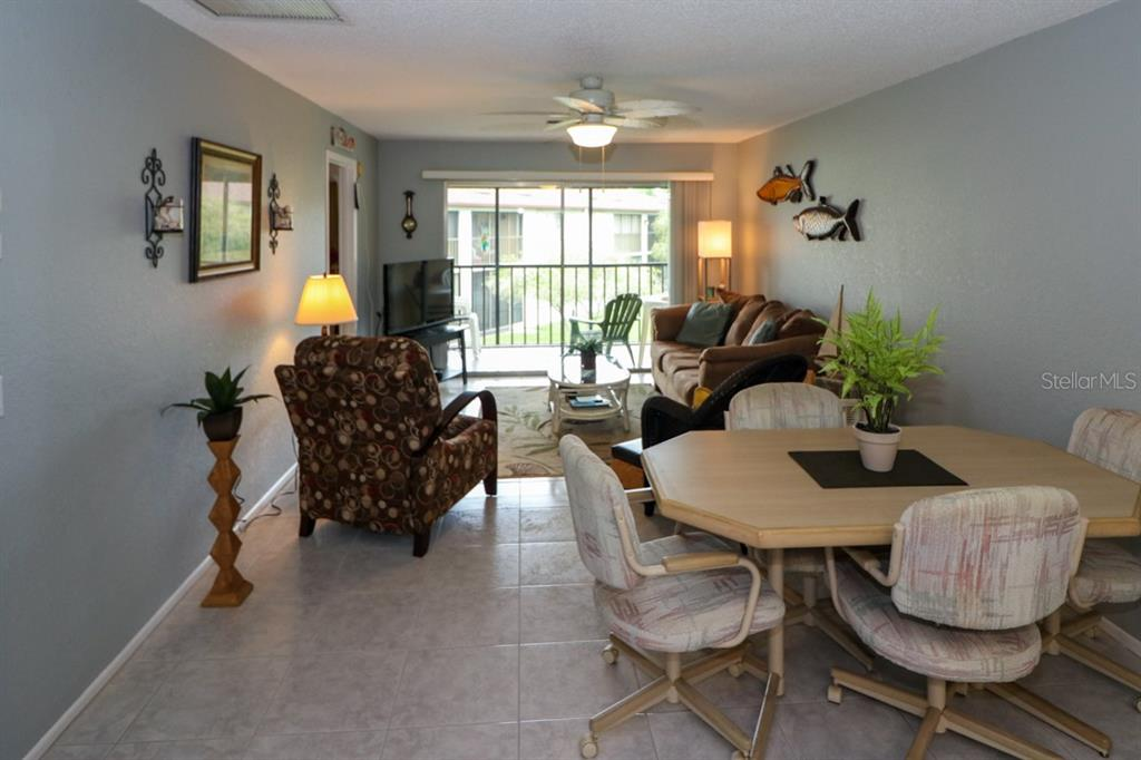 Living room and dining combo. - Condo for sale at 25100 Sandhill Blvd #M201, Punta Gorda, FL 33983 - MLS Number is C7433797