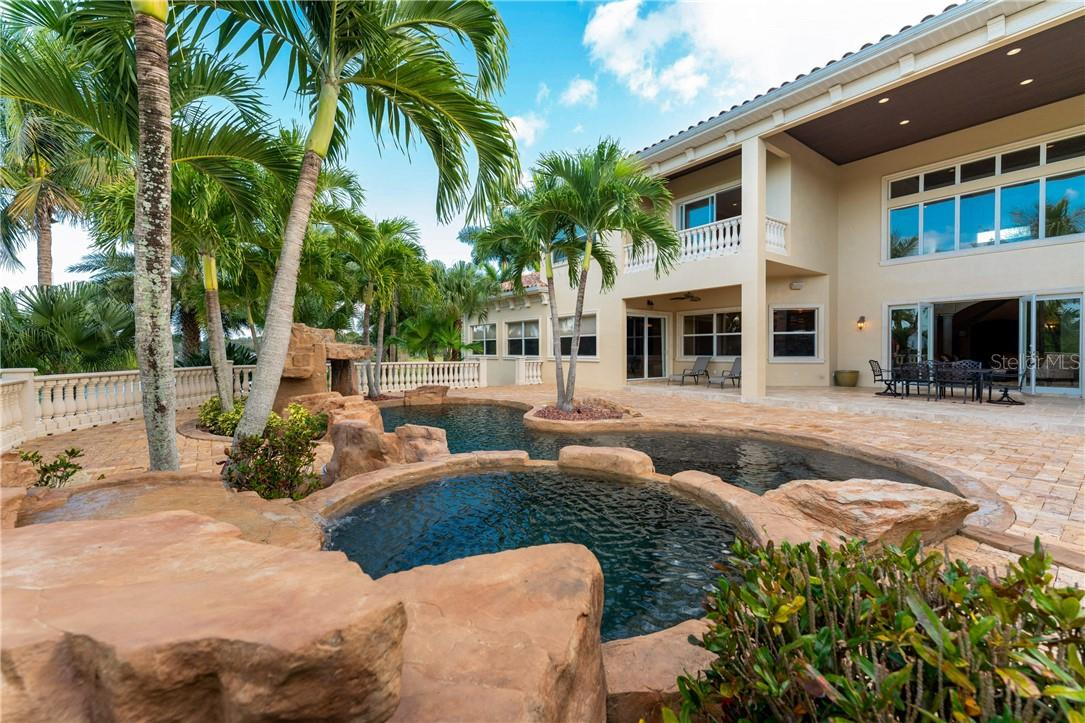 This tropical Spanish-Italian influenced estate fuses sophisticated grandeur with paradise living - Single Family Home for sale at 7440 Riverside Dr, Punta Gorda, FL 33982 - MLS Number is C7436263