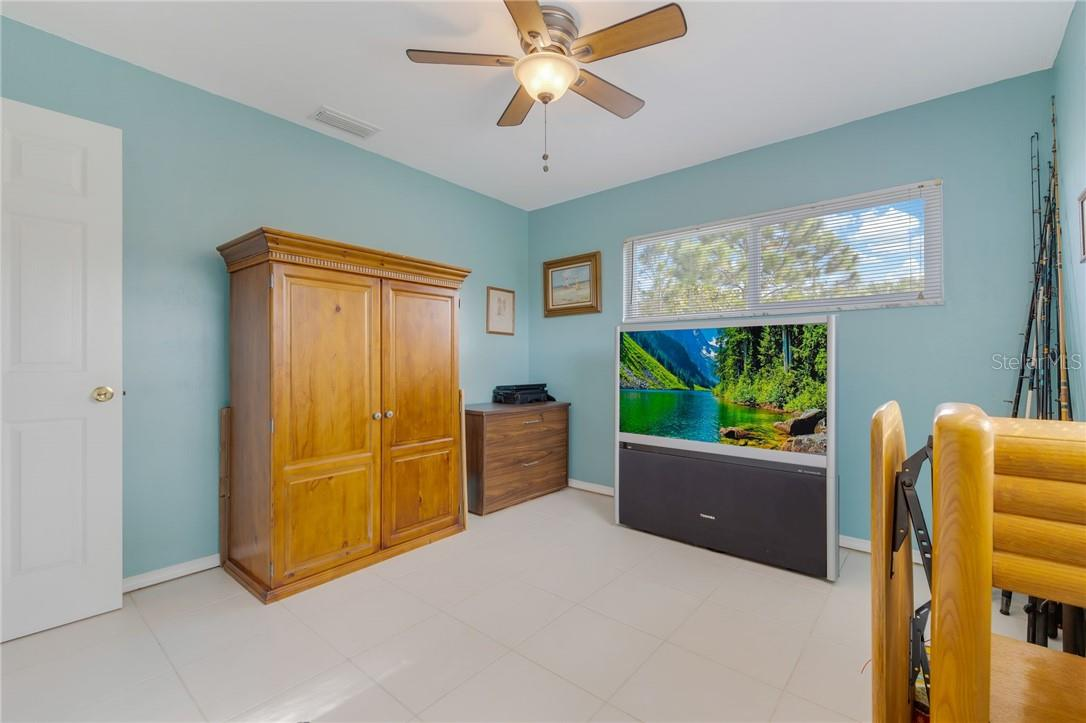 Spacious Bedroom 3 with windows to let the sun shine in all day. - Single Family Home for sale at 24368 Blackbeard Blvd, Punta Gorda, FL 33955 - MLS Number is C7436898