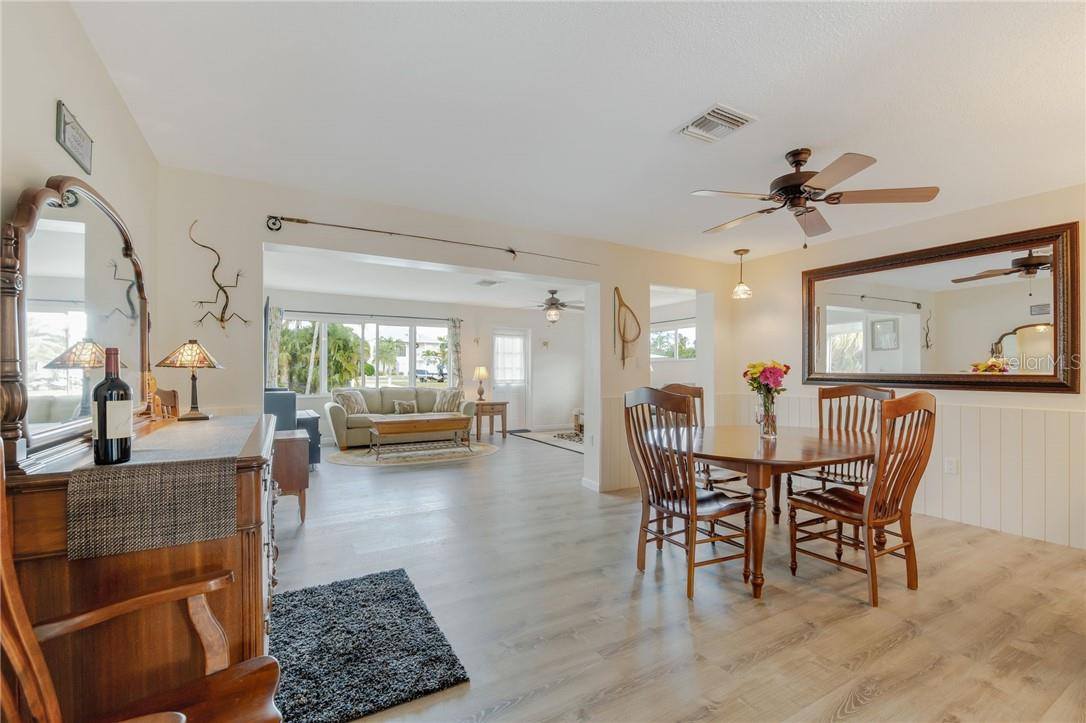 View from dining to living and out to the canal. - Single Family Home for sale at 24368 Blackbeard Blvd, Punta Gorda, FL 33955 - MLS Number is C7436898