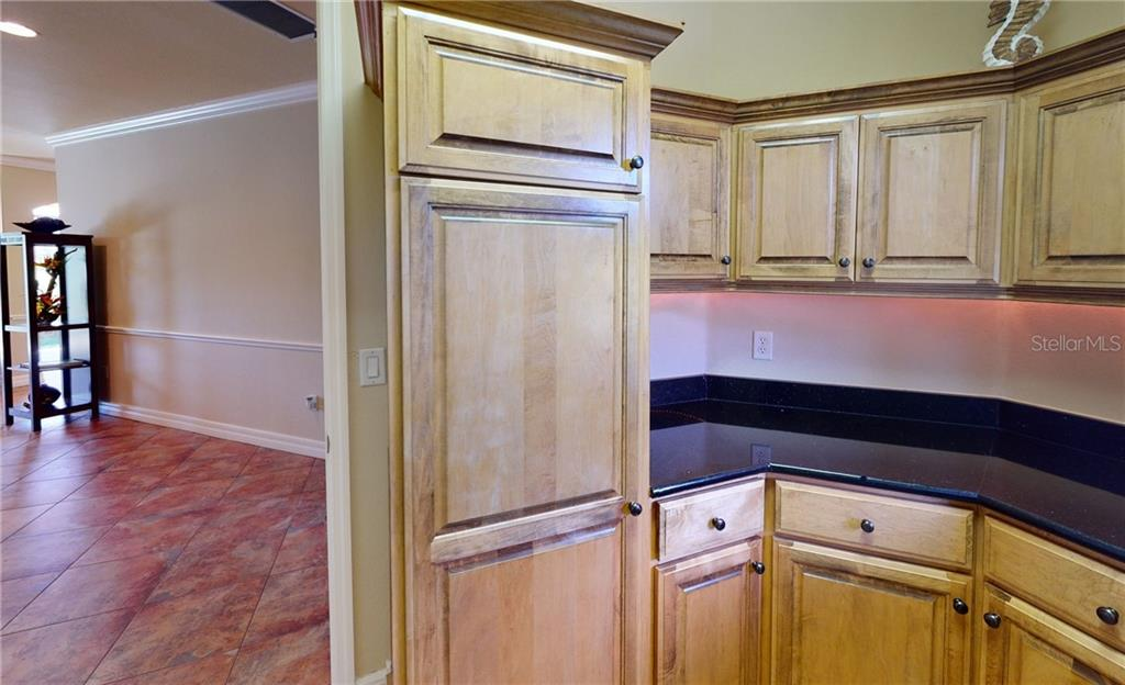 Laundry room cabinets. - Single Family Home for sale at 4245 Spire St, Port Charlotte, FL 33981 - MLS Number is C7437570