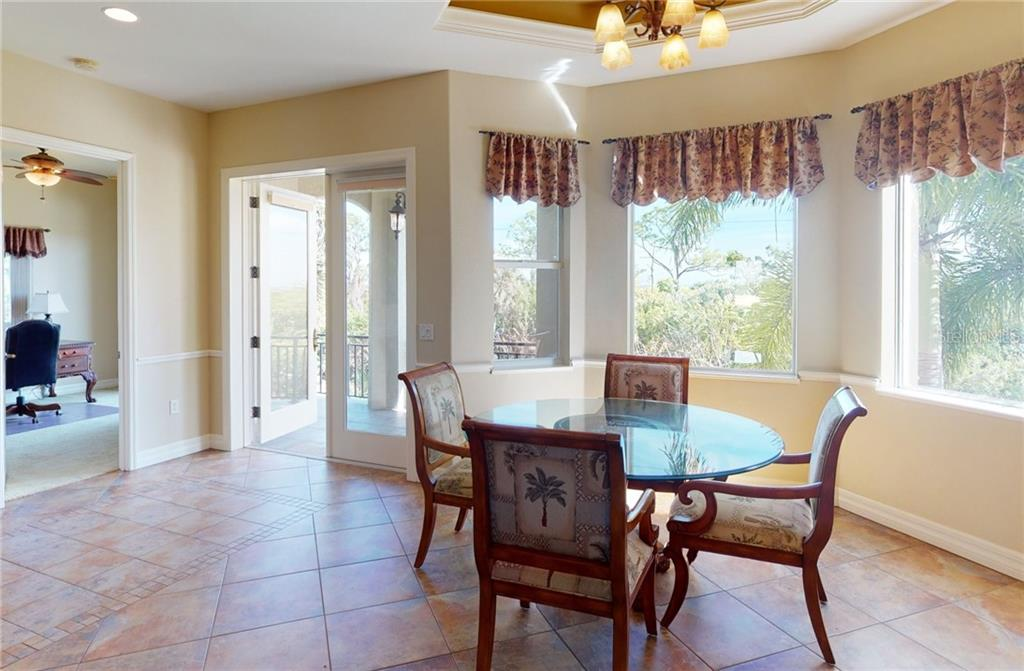 Breakfast nook area with French doors to balcony. - Single Family Home for sale at 4245 Spire St, Port Charlotte, FL 33981 - MLS Number is C7437570