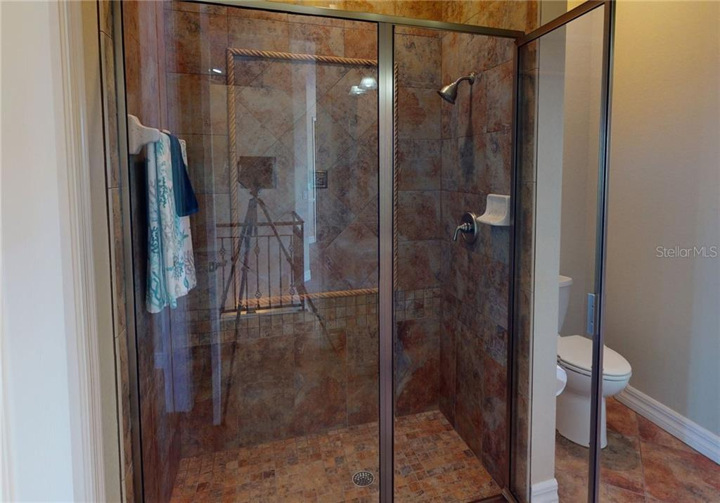 Tiled shower in 2nd floor guest bath. - Single Family Home for sale at 4245 Spire St, Port Charlotte, FL 33981 - MLS Number is C7437570