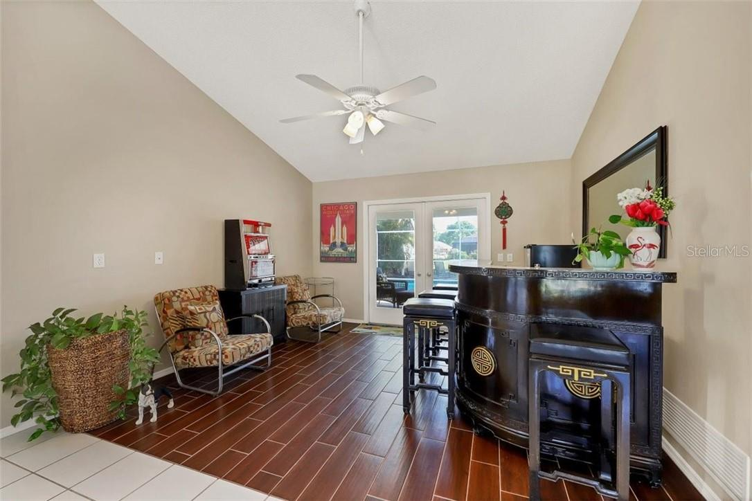 straight ahead aof double doors is the formal living room (used by current owners as den/entertaining room - note French doors to rear right out to lanai and pool - Single Family Home for sale at 116 Mariner Ln, Rotonda West, FL 33947 - MLS Number is C7441260