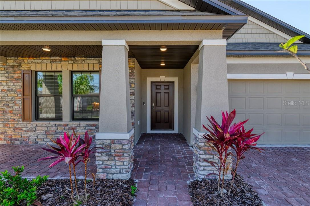 This gorgeous entry way and porch provides a warm welcome. - Single Family Home for sale at 2082 Apian Way, Port Charlotte, FL 33953 - MLS Number is C7441465