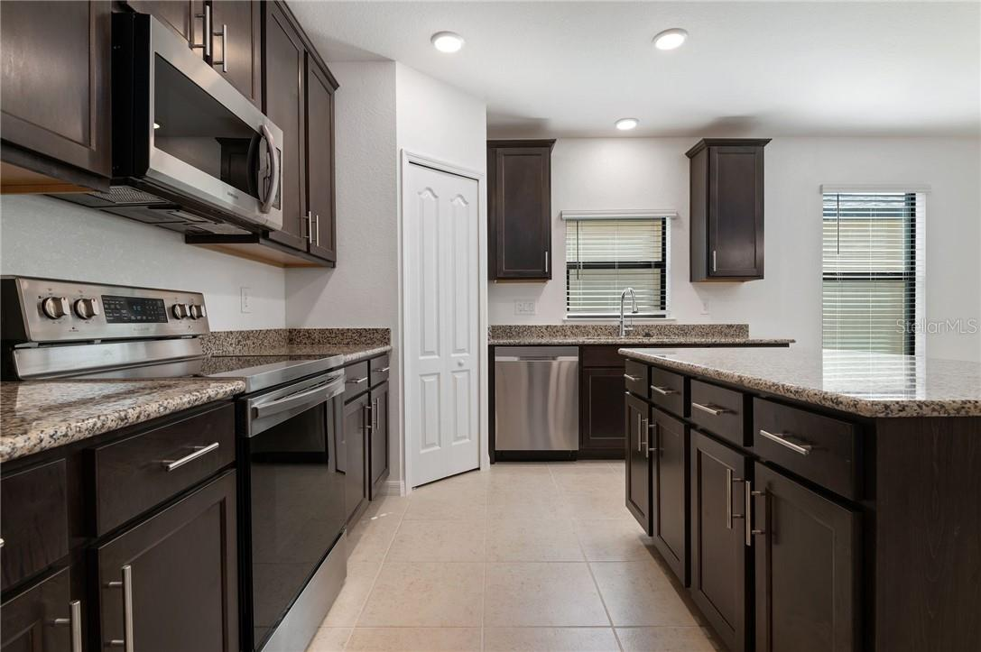 The kitchen and pantry has plenty of storage space. - Single Family Home for sale at 2082 Apian Way, Port Charlotte, FL 33953 - MLS Number is C7441465