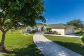 Wide sidewalk to courtyard and front entry - Single Family Home for sale at 515 Royal Poinciana Cir, Punta Gorda, FL 33955 - MLS Number is C7244338