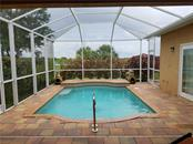 The inviting pool was recently added. - Single Family Home for sale at 2752 Suncoast Lakes Blvd, Punta Gorda, FL 33980 - MLS Number is C7402671