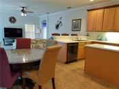 Eat-in kitchen and bar stool seating provides plenty of informal dining and space for entertaining. - Single Family Home for sale at 2752 Suncoast Lakes Blvd, Punta Gorda, FL 33980 - MLS Number is C7402671