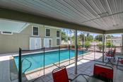 pool with view of guest house #2 - Single Family Home for sale at 3262 Great Neck St, Port Charlotte, FL 33952 - MLS Number is C7403390