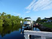 View down canal - Manufactured Home for sale at 66 Windmill Blvd, Punta Gorda, FL 33950 - MLS Number is C7405183