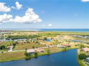 Looking West toward Charlotte Harbor and other lakes in the community - Single Family Home for sale at 24126 Santa Inez Rd, Punta Gorda, FL 33955 - MLS Number is C7416081