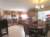 Kitchen and Dinng - Single Family Home for sale at 4275 Tollefson Ave, North Port, FL 34287 - MLS Number is C7416188