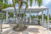 Sun or shade at the pool - your choice - Single Family Home for sale at 124 Useppa Is, Captiva, FL 33924 - MLS Number is C7419408