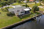 Oversized lot with room for a pool, or expanded garage, living space. - Single Family Home for sale at 24368 Blackbeard Blvd, Punta Gorda, FL 33955 - MLS Number is C7436898