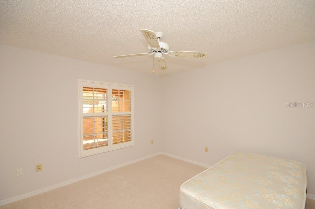 Bedroom 2 - Villa for sale at 5510 Chanteclaire #46, Sarasota, FL 34235 - MLS Number is A4156527