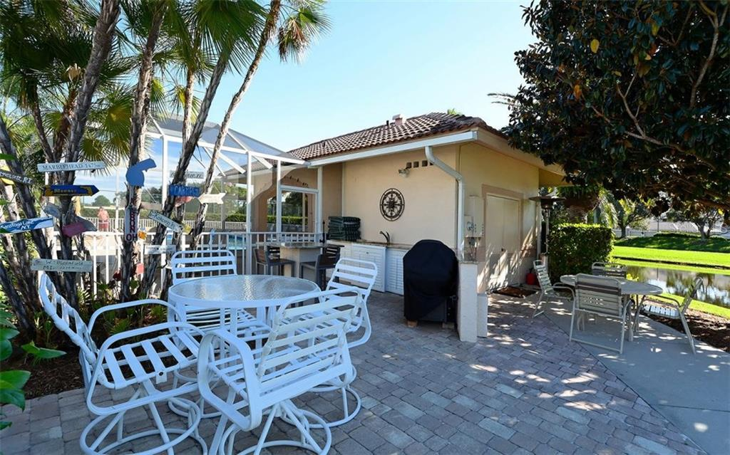 Club South grilling area and gathering place. - Condo for sale at 9630 Club South Cir #6103, Sarasota, FL 34238 - MLS Number is A4166105
