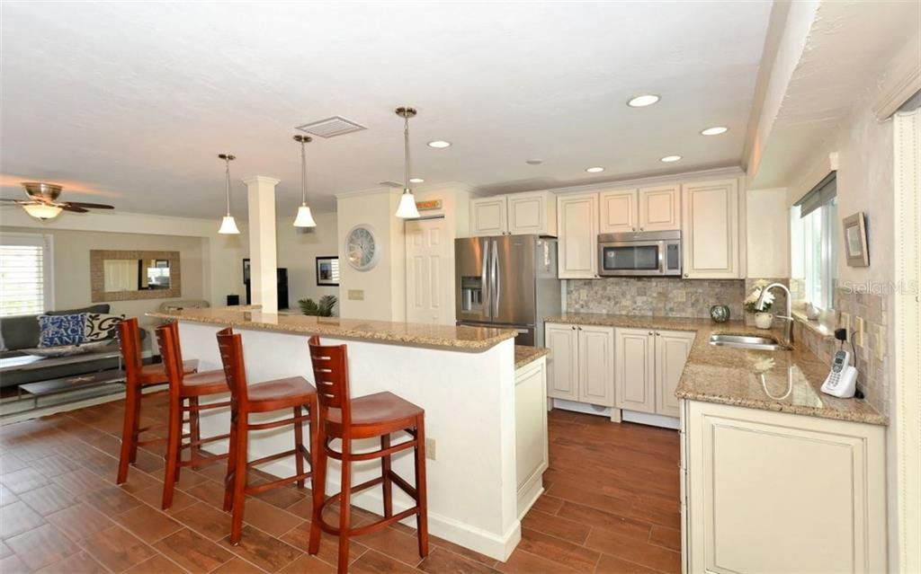 Kitchen - Single Family Home for sale at 5830 Midnight Pass Rd #504, Sarasota, FL 34242 - MLS Number is A4166623