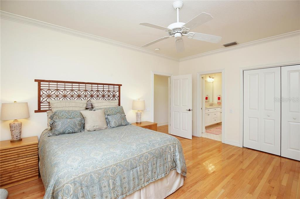 One of Two Guest Bedrooms on the Second Level with a Private Entrance.  Joint with a Jack & Jill bathroom to Second Guest Bedroom!  Both have walkout Balconies! - Single Family Home for sale at 722 Siesta Dr, Sarasota, FL 34242 - MLS Number is A4169257