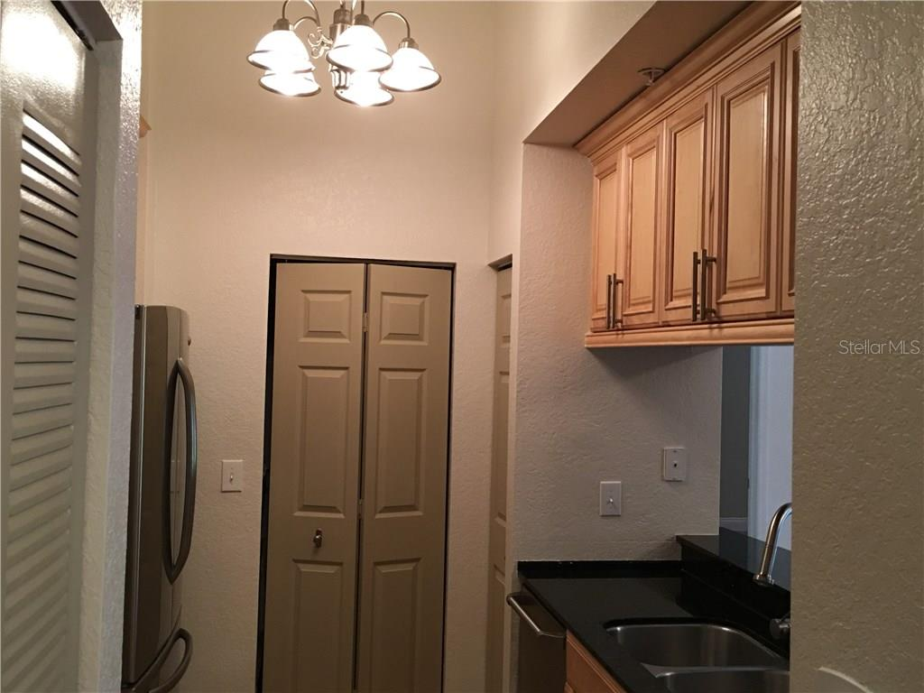 At the end of the kitchen is the utility closet with washer and dryer. - Condo for sale at 1064 N Tamiami Trl #1131, Sarasota, FL 34236 - MLS Number is A4174927