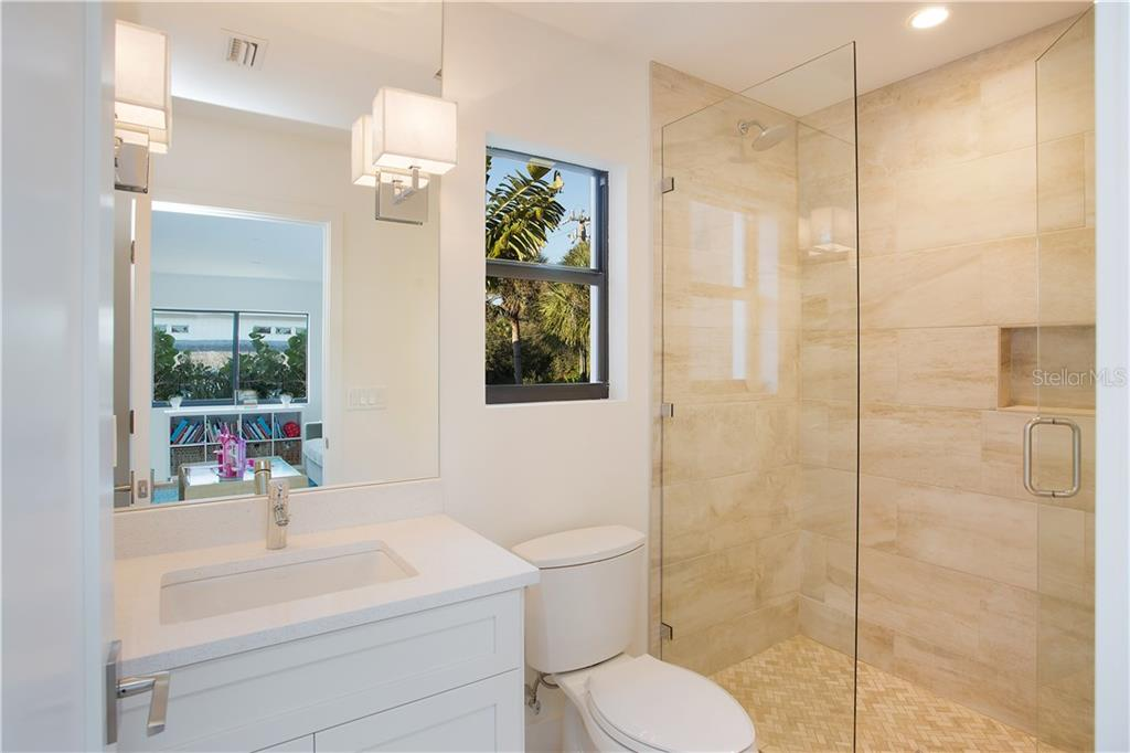 Private bathroom for the 4th bedroom. - Single Family Home for sale at 4934 Commonwealth Dr, Sarasota, FL 34242 - MLS Number is A4175945
