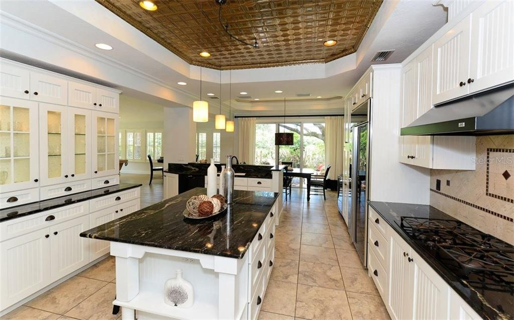 Single Family Home for sale at 7618 Midnight Pass Rd, Sarasota, FL 34242 - MLS Number is A4176380